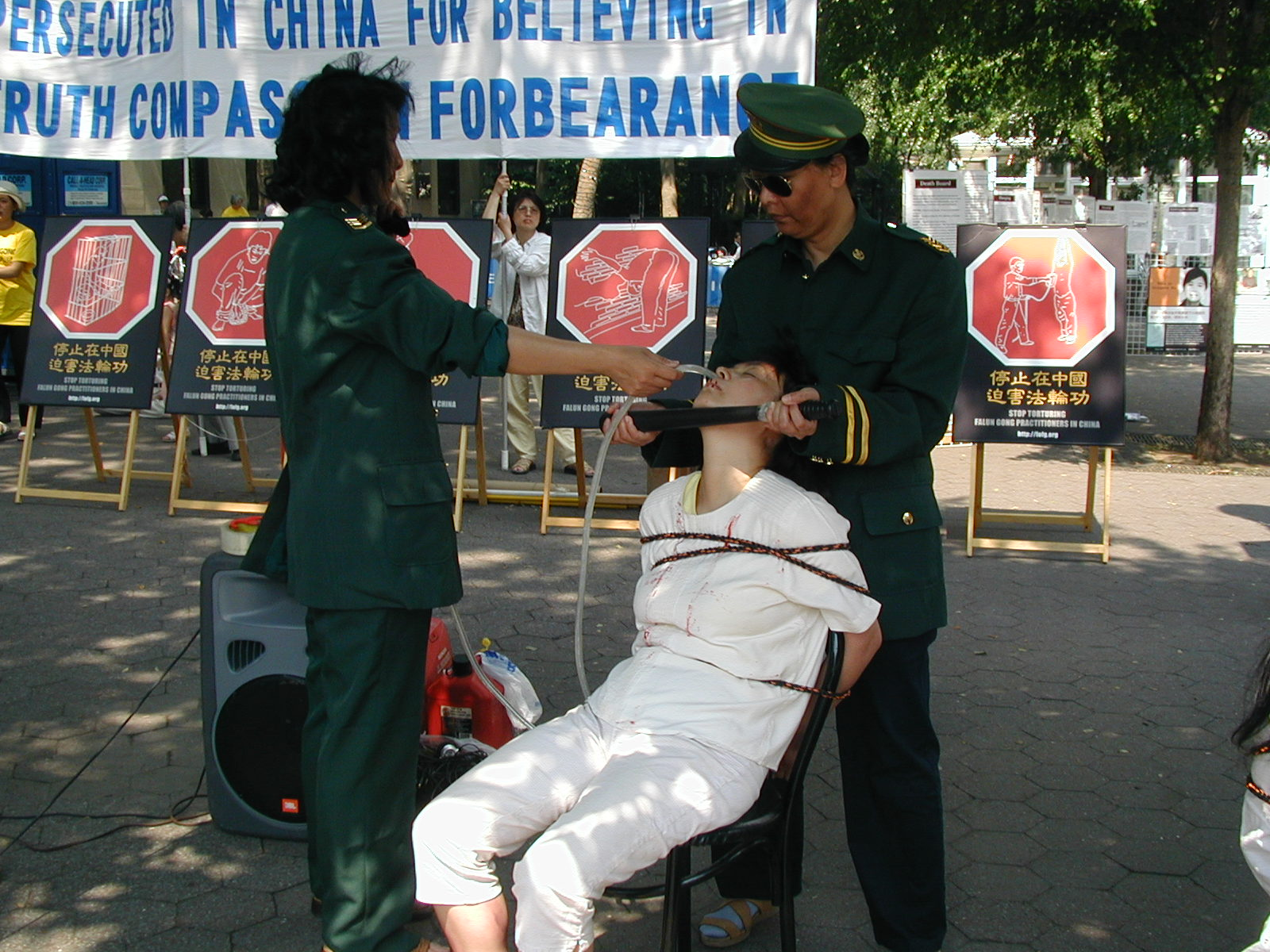 Practitioners Tortured with Carrying a Sword on the Back (Photos)   Falun Dafa - Minghui.org